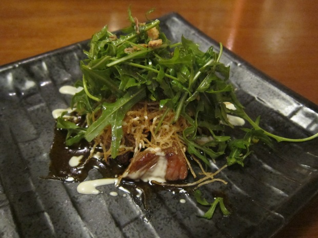 grilled teriyaki wagyu, with rocket and eschallot crisps